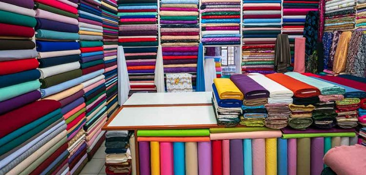 shelf-wide-selection-colorful-fabrics-ribbons-how-to-organize-fabrics-ss-featured-750x420